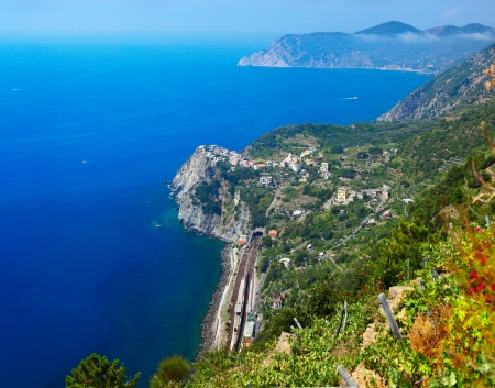 Cinque Terre National Park, View to Corniglia town from mountain at sunny day. Italy photo