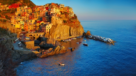 Cinque Terre National Park, Manarola town at sunset. Italy photo