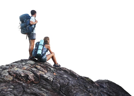 Two hikers with backpacks on top of a mountain isolated on a white photo