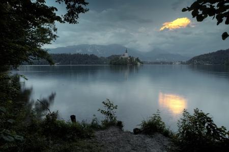 bled: Dark sunset over lake of Bled, Slovenia Stock Photo