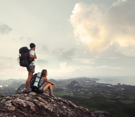 Hikers with backpacks enjoying valley view from top of a mountain Stock Photo - 16840927