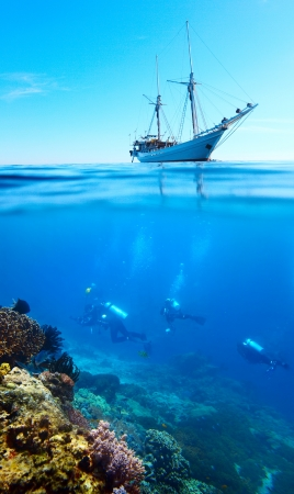 Collage of scuba divers exploring a coral reef and anchored sail boat on a surface photo