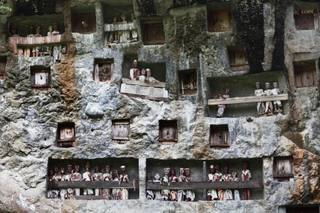 sulawesi: Traditional statues tau tau on a rock wall. Toraja region of Sulawesi island. Indonesia