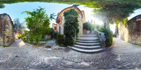 equirectangular: Spherical 360 degrees panorama of cosiness yard with trees and tile passages in the city of Verona at early morning