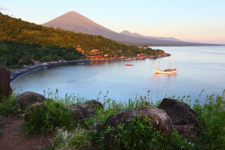 Calm lagoon with clear water and volcano Agung on the background. Jemaluk village, Bali, Indonesia Stock Photo - 16875511
