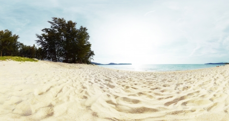 Panorama of a tropical beach with white sand and green trees on the coast. Bang Tao beach of Phuket island, Thailand Stock Photo - 16875500