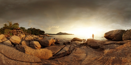Wide angle panorama of a rocky coast of Andaman sea near Laem Sing beach at sunset light. Phuket, Thailand Stock Photo - 16875501