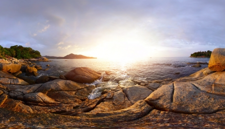 Panorama of a rocky coast of Andaman sea near Laem Sing beach at sunset. Phuket, Thailand Stock Photo - 16875480