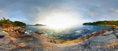 Panorama of a rocky coast of Andaman sea near Laem Sing beach at sunset. Phuket, Thailand Stock Photo - 16875530