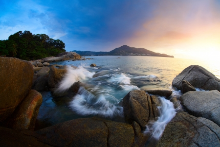 Rocky coast of Andaman sea near Laem Sing beach at sunset light. Phuket, Thailand Stock Photo - 16875504