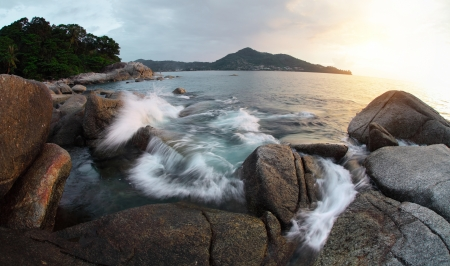 Rocky coast of Andaman sea near Laem Sing beach at sunset light. Phuket, Thailand Stock Photo - 16875492