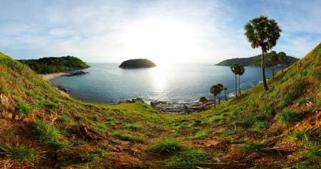 Panorama of tropical coast with beach,  palm trees and island in calm blue sea. Ya Nui beach (left sandy coast) of Phuket. Thailand Stock Photo - 16875526