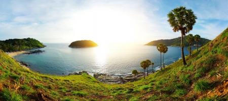 Panorama of tropical coast with beach,  palm trees and island in calm blue sea. Ya Nui beach (left sandy coast) of Phuket. Thailand Stock Photo - 16875514