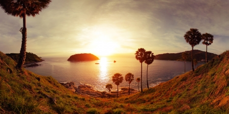 Panorama of tropical coast with beach,  palm trees and island in calm sea at twilight. Nai Harn's beach area of Phuket. Thailand Stock Photo - 16875493