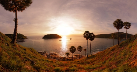 Panorama of tropical coast with beach,  palm trees and island in calm blue sea. Nai Harn beach area of Phuket. Thailand Stock Photo - 16875512