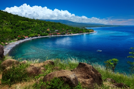 Calm lagoon with clear water and green coast of Jemaluk village. Bali, Indonesia Stock Photo - 16875521