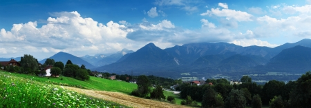 Alpine valley with tall mountains and green meadows with buildings Stock Photo - 16875524