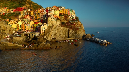 Panorama of Manarola town of Cinque Terre National Park at calm sunny day, Italy photo
