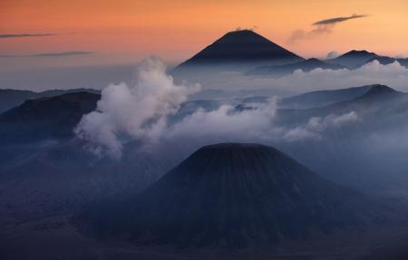 Volcanoes in Bromo Tengger Semeru National Park at sunset. Java, Indonesia Stock Photo