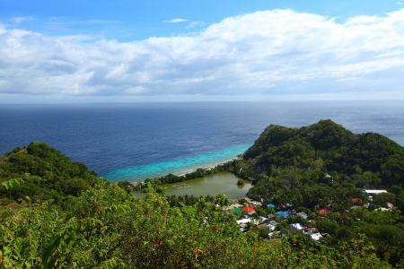apo: Green tropical island with village surrounded by blue clear sea. Apo island, Philippines