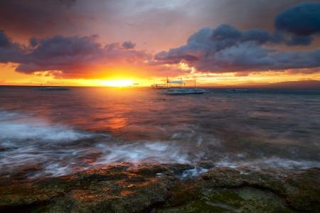 apo: Sunset over rocky coast of Apo island, Philippines