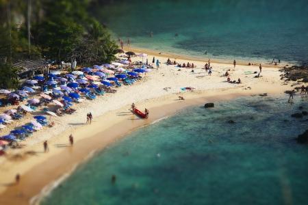 tilt shift: Tropical sandy beach and calm lagoon with clear blue water. Pseudo tilt shift. Ya Nui beach, Phuket, Thailand