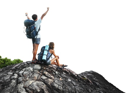 Two hikers with backpacks on top of a mountain isolated on a white background photo