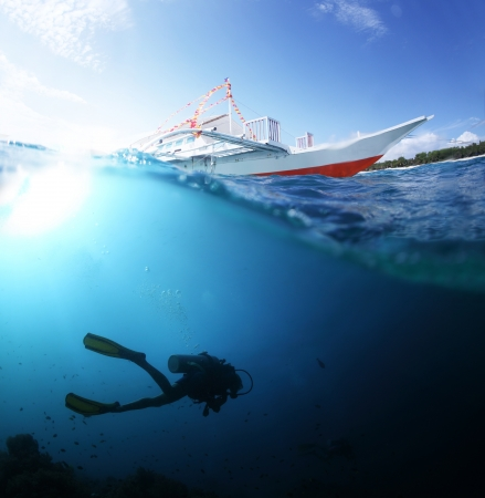 dive trip: Collage with scuba diver underwater and traditional boat on a surface at sunny day Stock Photo