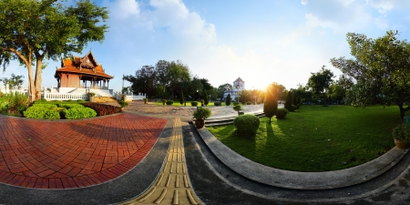 equirectangular: Panorama of a green garden with buddhist building and walkways at early morning. Bangkok, Thailand