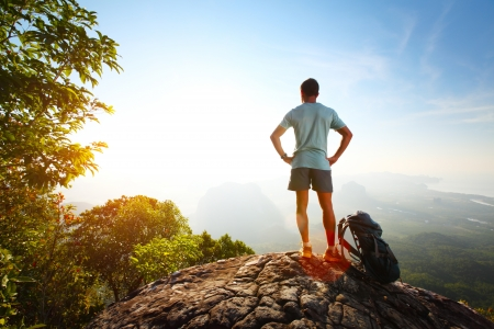 Young hiker relaxing on top of a mountain photo