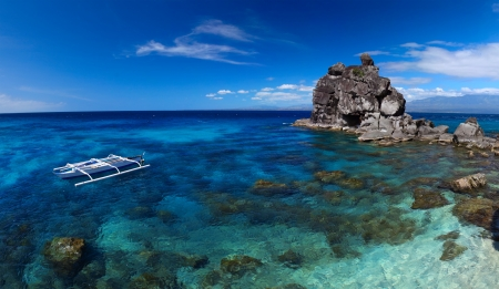 apo: Clear tropical sea and white national boat anchored on coast of Apo island. Philippines