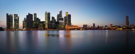 Panorama of a big city with tall buildings reflected in a water. Singapore photo