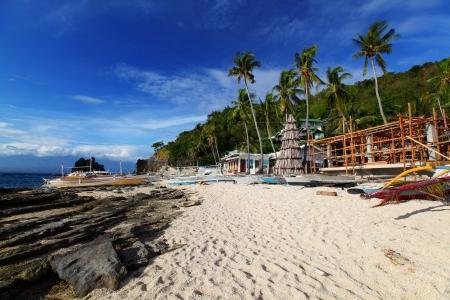 apo: Rocky coast of tropical Apo island, Philippines Stock Photo