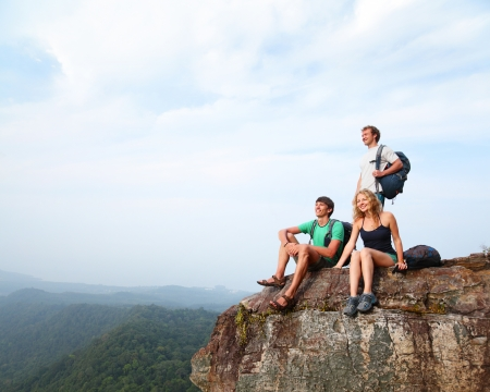 Young hikers relaxing on top of a mountain Stock Photo - 19872919