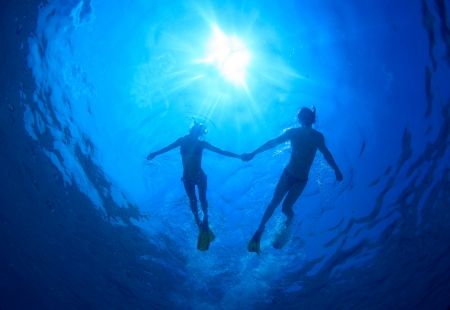 topical: Young couple snorkeling together in a topical sea Stock Photo