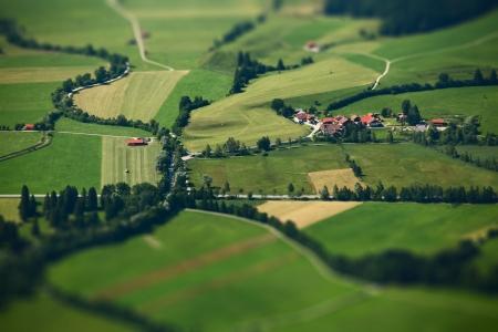 tilt shift: Small Bavarian village in a fields, Germany. Pseudo tilt shift effect