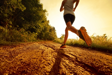 extremes: Young lady running on a rural road Stock Photo
