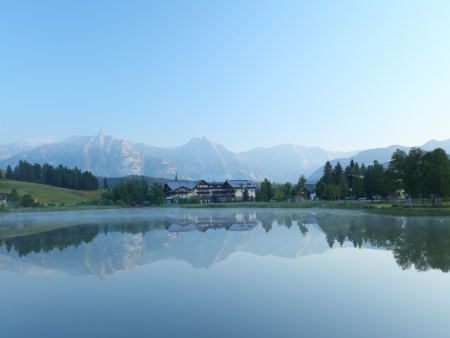 still water: Pond in Alps with clear still water surface. Seefeld, Austria Stock Photo