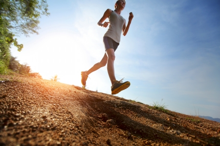 Young lady running on a rural road photo