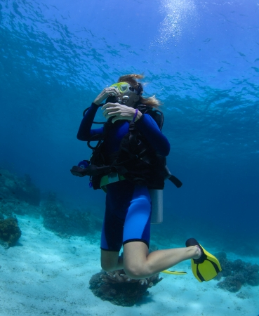 presure: Scuba diver trying to equalize presure on the depth Stock Photo