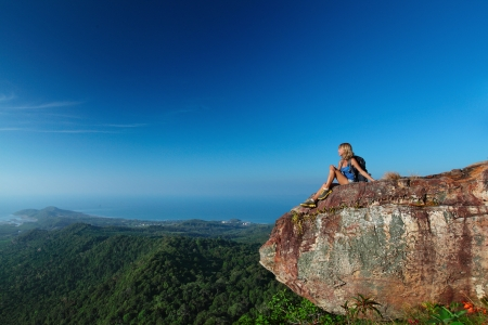 woman mountain: Female hiker with backpack relaxing on top of a mountain