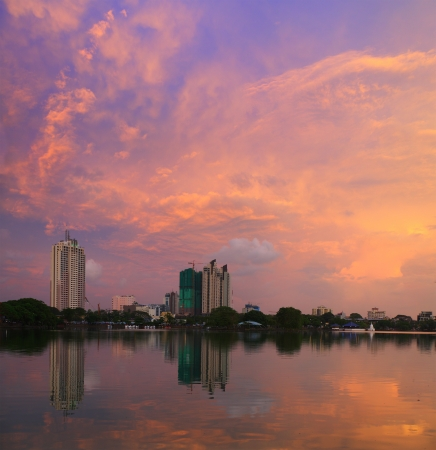 Buildings in a city of Colombo with reflection in a pond at sunset  Sri Lanka Stock Photo