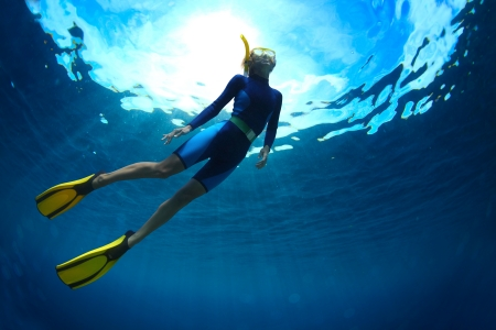 freediving: Young woman freediving in a clear sea