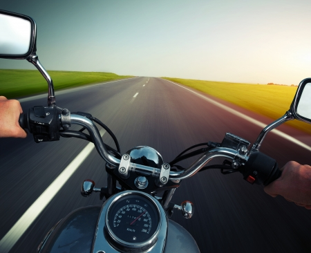 motorcycle road: Driver riding motorcycle on an empty asphalt road Stock Photo