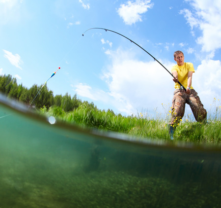 Young man fishing on a green ponds coast with underwater view of weed on a bottom photo