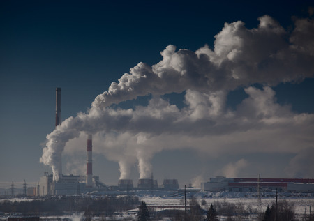 Energy plant with a smoke at sunny day photo