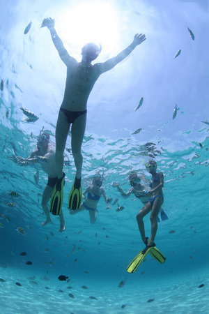 Young friends snorkeling in a tropical sea photo