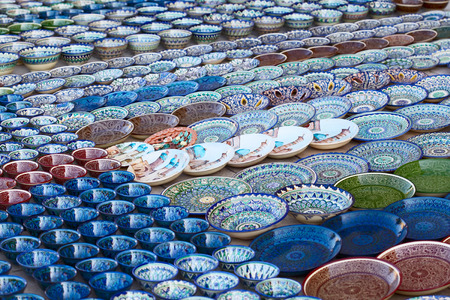 Rows of cups on a street market in the city of Bukhara, Uzbekistan photo