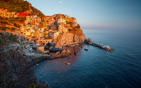 Manarola town of Cinque Terre National Park at sunset, Italy photo