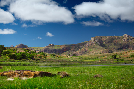anja: Mountains of Anja National Park at sunny day and fluffy clouds in the sky. Madagascar Stock Photo
